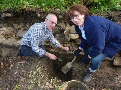 Volunteer archaeologists excavating